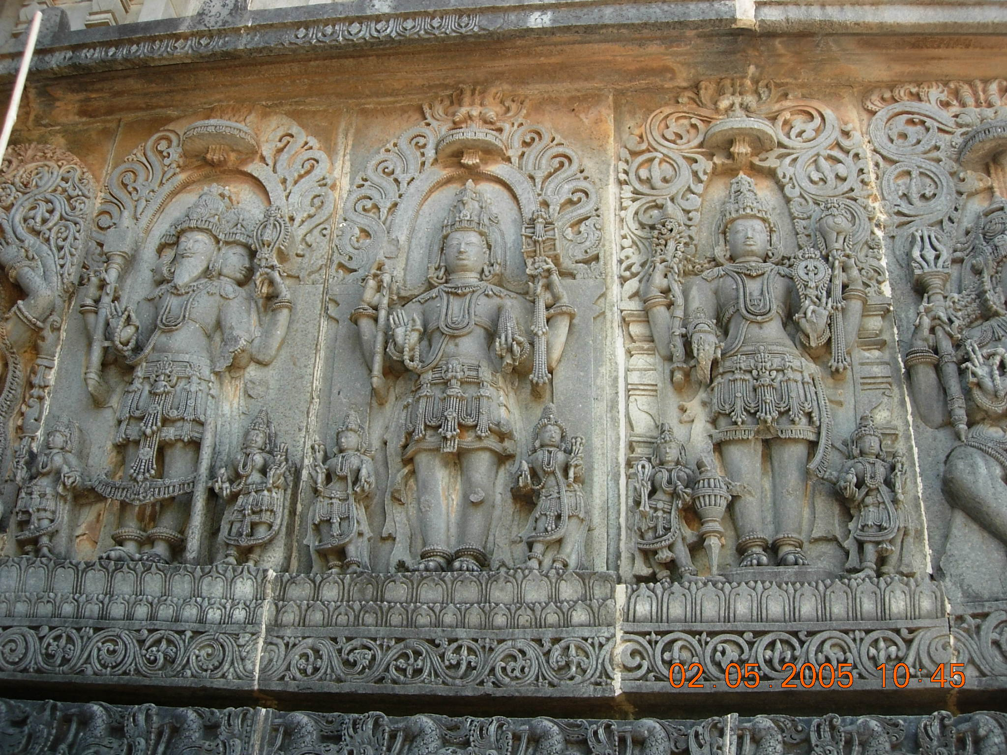 hinduism and islam differences and similarities  temple carving at hoy swara temple representing the trimurti brahma shiva and vishnu