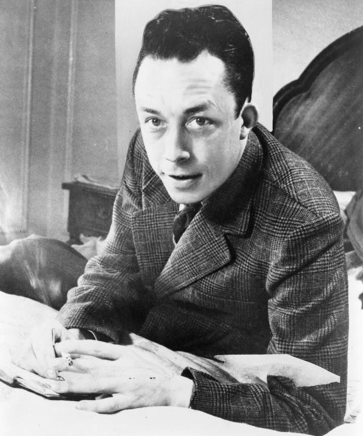 critical review of the stranger by albert camus writework albert camus nobel prize winner half length portrait seated at desk