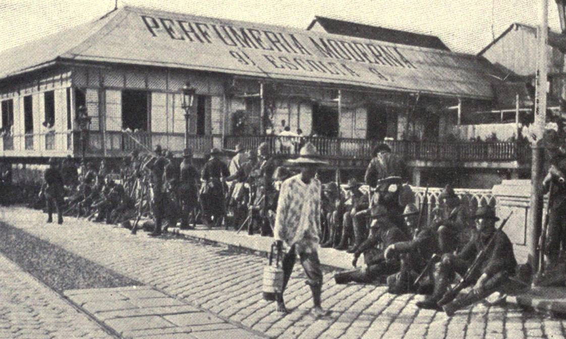 during the spanish american war fighting was taking place in the original caption cropped out american troops guarding the bridge over the river pasig