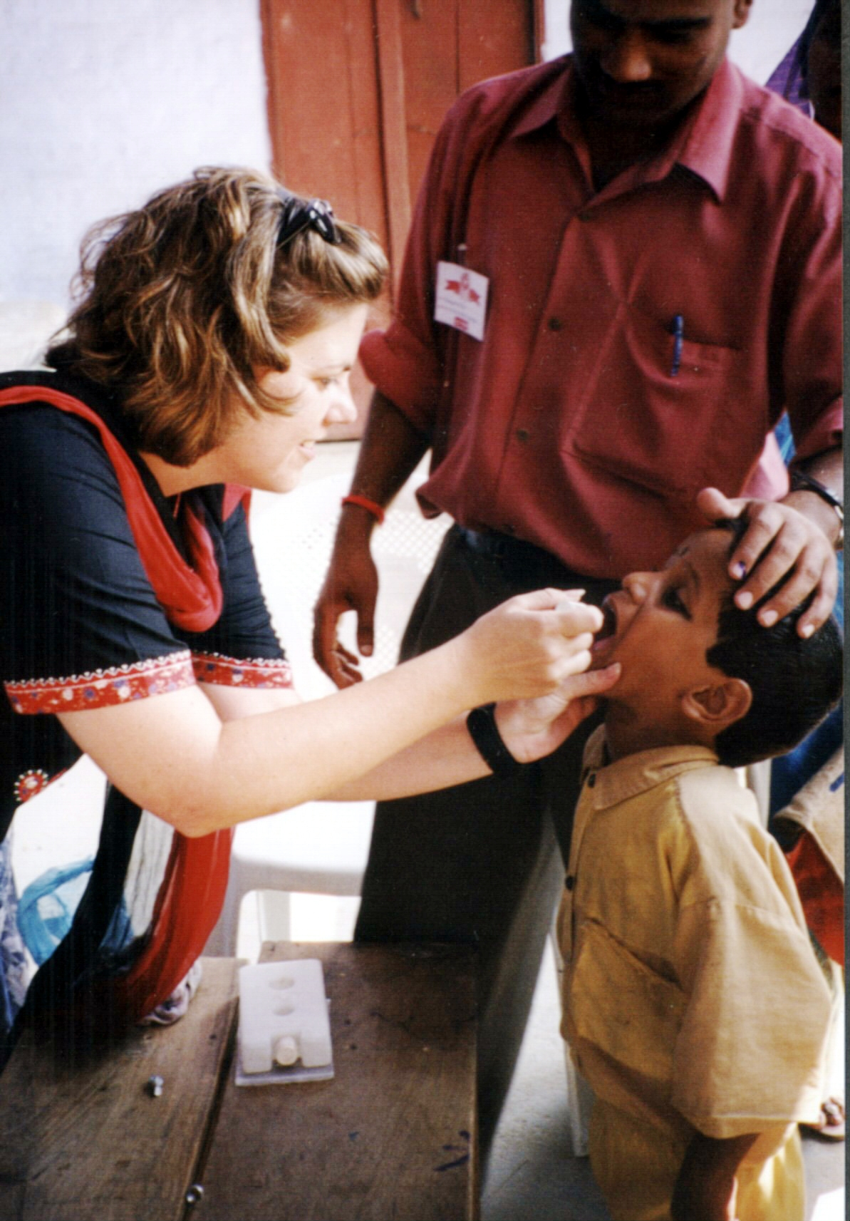 polio essay  a child receives oral polio vaccine during a 2002 campaign to immunize children in