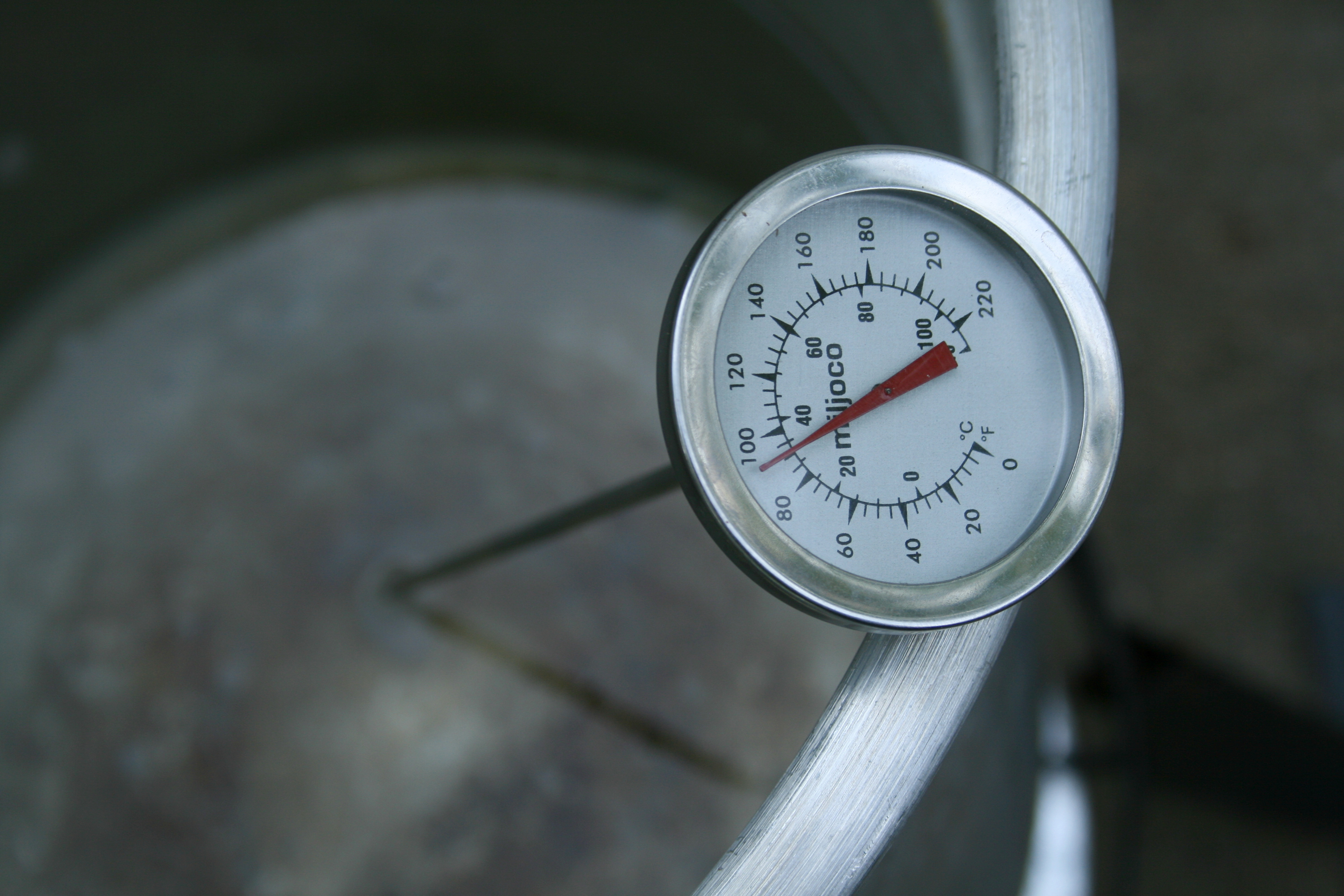 English A Thermometer In Bucket Of Heated Water Reading 92 Degrees Celsius