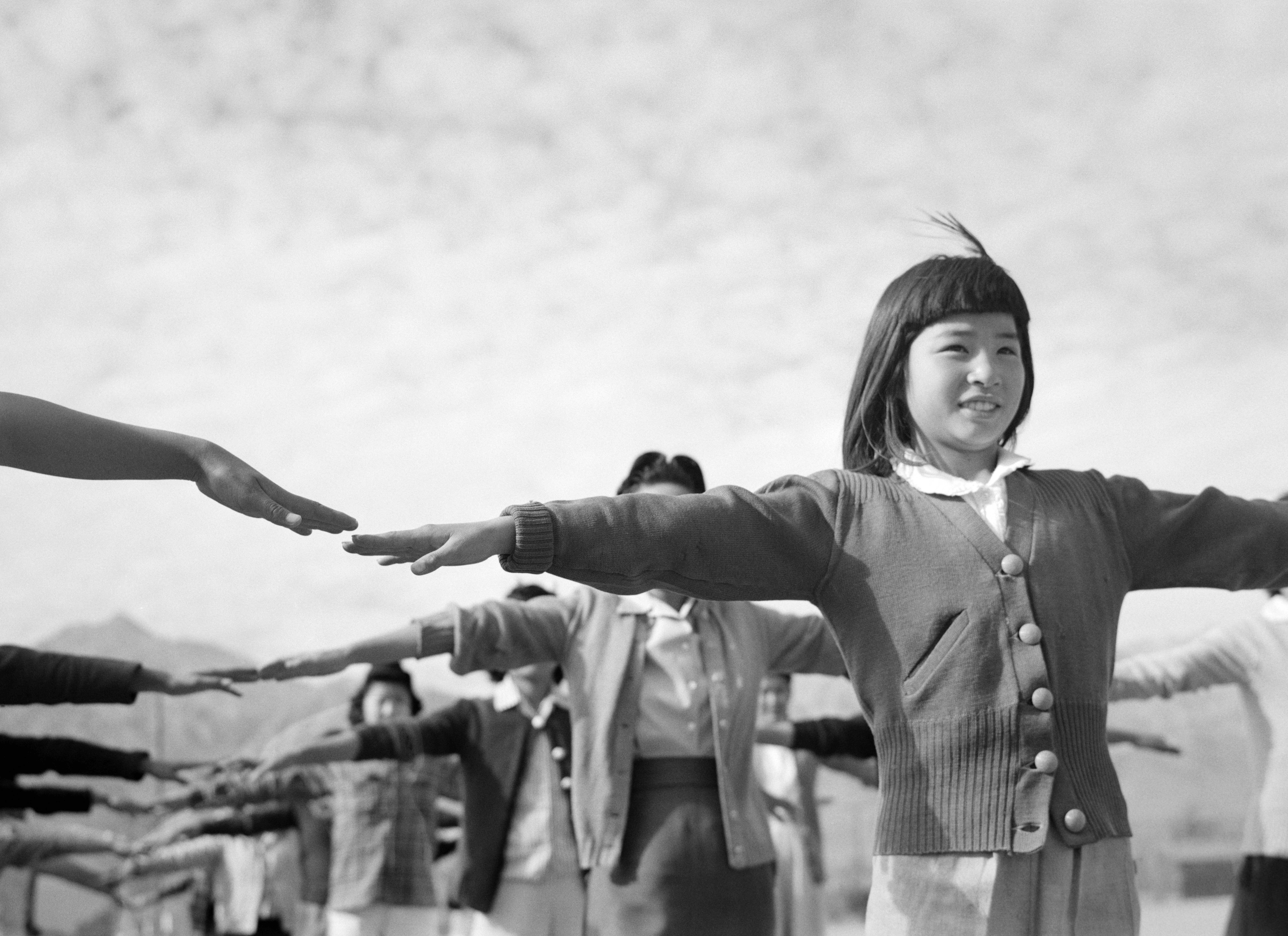 farewell to manzanar an essay on the book farewell to manzanar  camp life at manzanar female internees practicing calisthenics